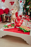 Red porcelain teapot and cookies Royalty Free Stock Photo