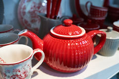 Red porcelain teapot in sideboard Stock Photos