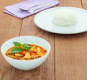 Red pork curry (Panang) with rice. In white plate on wooden background, Thai food Royalty Free Stock Images
