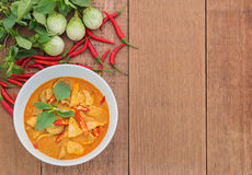 Red pork curry (Panang) with vegetable on wooden background. Thai food Royalty Free Stock Photo