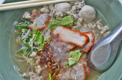 Red pork noodles. With flavoring close up Stock Image