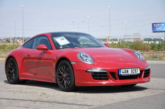 Red Porsche 911 Carrera 4 GTS Stock Photo