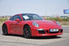 Red Porsche 911 Carrera 4 GTS Stock Photo