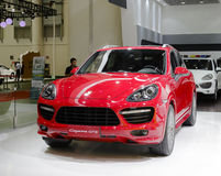 Red porsche cayenne gts suv car Stock Images