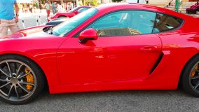 Red Porsche Cayman GT4 side view stock video footage