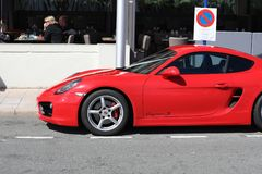 Red Porsche 718 Cayman S - Badly Parked Car. Menton, France - March 19, 2018: Luxury Red Porsche 718 Cayman S Badly Parked Car In The Street Of Menton On The Stock Images