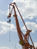 Red port crane. A crane in the port/harbor of Pula on a sunny day with a blue sky Royalty Free Stock Images