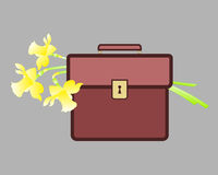 Red portfolio with spring yellow flowers. Royalty Free Stock Image