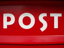 Red post box. Close-up of a red post box royalty free stock photography