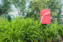 Red post box in green forest Royalty Free Stock Images