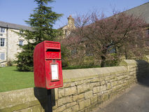 Red Post Box in the orphanage Village of Edgeworth Bolton England Royalty Free Stock Image