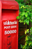 Red post box set against nature background. At Chiang mai, Thailand Royalty Free Stock Photos