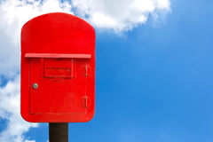 Red post box and sky Stock Images