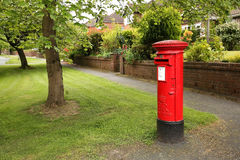 Red post box in the UK Stock Image