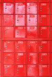 Red post boxes. Red postal boxes at a New Zealand post office Stock Image