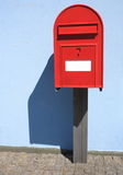 Red postbox letterbox on the street Royalty Free Stock Photography