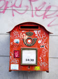 Red postbox in the street. And graffiti Royalty Free Stock Photos