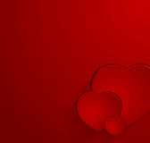 Red postcard with three hearts Royalty Free Stock Image