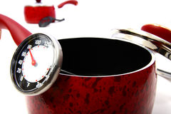 Red pot. A red pot with thermometer stock photo