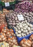 Red potato and onion for sale Stock Photo