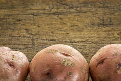 Red potatoes on rustic wood Stock Image