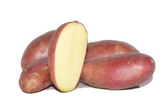 Red potatos and one cut. Red potatos one cut in half Royalty Free Stock Photography