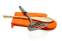 Red potholder Glove with Spatula and Cooking Spoon Stock Photo