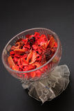 Red Potpourri in crystal bowl. Potpourri placed in a crystal bowl adorned with lace ribbons Royalty Free Stock Photo