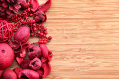 Red potpourri on wood with copy space Royalty Free Stock Photo