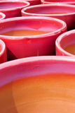 Red Pots. A collection of bright red and purple glazed flower pots Royalty Free Stock Photos
