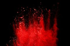 Red powder explosion isolated on black background. stock image