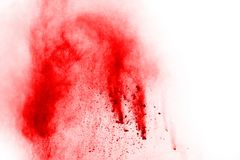 Red powder explosion on white background. Freeze motion of red powder exploding, isolated on white background. Abstract design of red dust cloud. Particles stock images