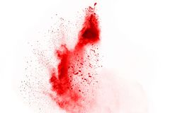 Red powder explosion on white background. Freeze motion of red powder exploding, isolated on white background. Abstract design of red dust cloud. Particles stock photos