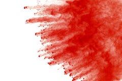 Red powder explosion on white background. Paint Holi. stock photography