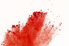 Red powder explosion on white background. Paint Holi. royalty free stock photography