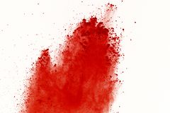 Red powder explosion on white background. Paint Holi.  royalty free stock images