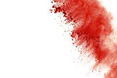 Red powder explosion on white background. Paint Holi. stock photos