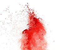 Red powder explosion on white background. Paint Holi. stock photography