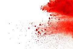 Red powder explosion on white background. Paint Holi. stock image
