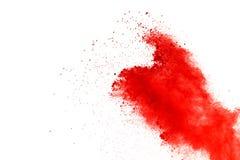 Red powder explosion on white background. Paint Holi. stock photos