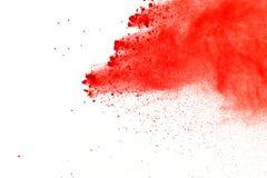 Red powder explosion on white background. Paint Holi. royalty free stock image