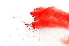 Red powder explosion on white background. Paint Holi. royalty free stock photo
