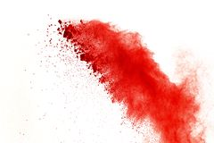 Red powder explosion on white background. Paint Holi. stock images