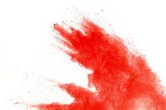 Red powder explosion on white background. Paint Holi stock photo