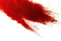 Red powder explosion on white background. Paint Holi royalty free stock images