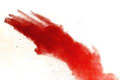 Red powder explosion on white background. Paint Holi royalty free stock image