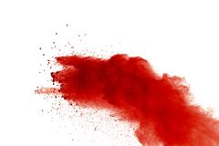 Red powder explosion on white background. Paint Holi stock images