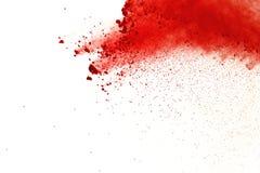 Red powder explosion on white background. Paint Holi. stock image