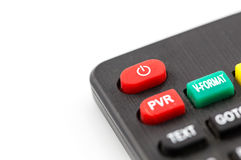 Red power button on a remote control for a TV. Closeup image of a red power button on a remote control for a TV or another entertainment device Stock Image