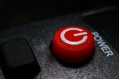 Red power key with black background stock photography